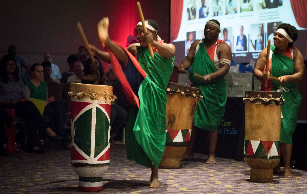 JPS Health Network transport operator Leonard Ndabahinuye, from left, kicks a leg over a drum with interpreter Ferdinand Bangirinama and housekeeper Marcelina Niyonzima in a performance that won first place in the 2017 Live! @JPS Talent Show. The trio's centuries-old Burundi performance relayed important events interpreted through percussion and dance.