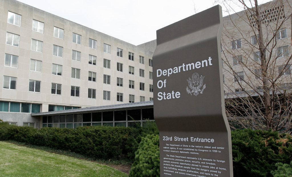 In this Dec. 15, 2014 file photo, the State Department in Washington. U.S. officials say the Trump administration is proposing deep cuts in funding for diplomacy and foreign aid to help pay for increased military spending.  (AP Photo/Luis M. Alvarez, File)
