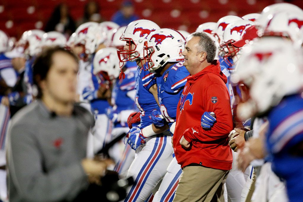 New Southern Methodist Mustangs head coach Sonny Dykes walks with his team before the NCAA 2017 DXL Frisco Bowl between the Louisiana Tech Bulldogs and the SMu Mustangs at Toyota Stadium in Frisco, Texas Wednesday December 20, 2017. (Andy Jacobsohn/The Dallas Morning News)