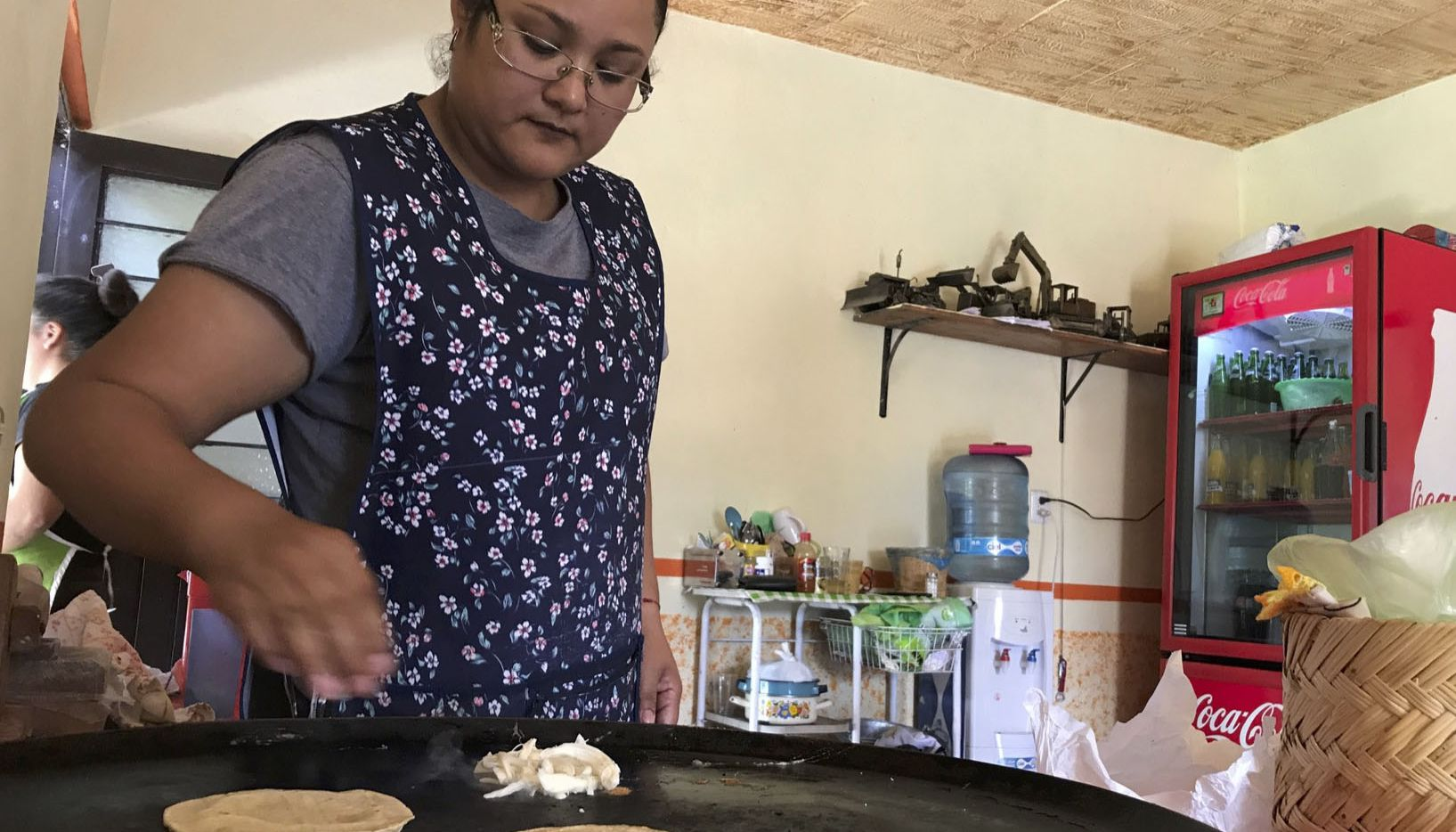 Yanet Lopez prepares quesadillas in her Guanajuato home, site of the upcoming Toyota plant that's under construction.