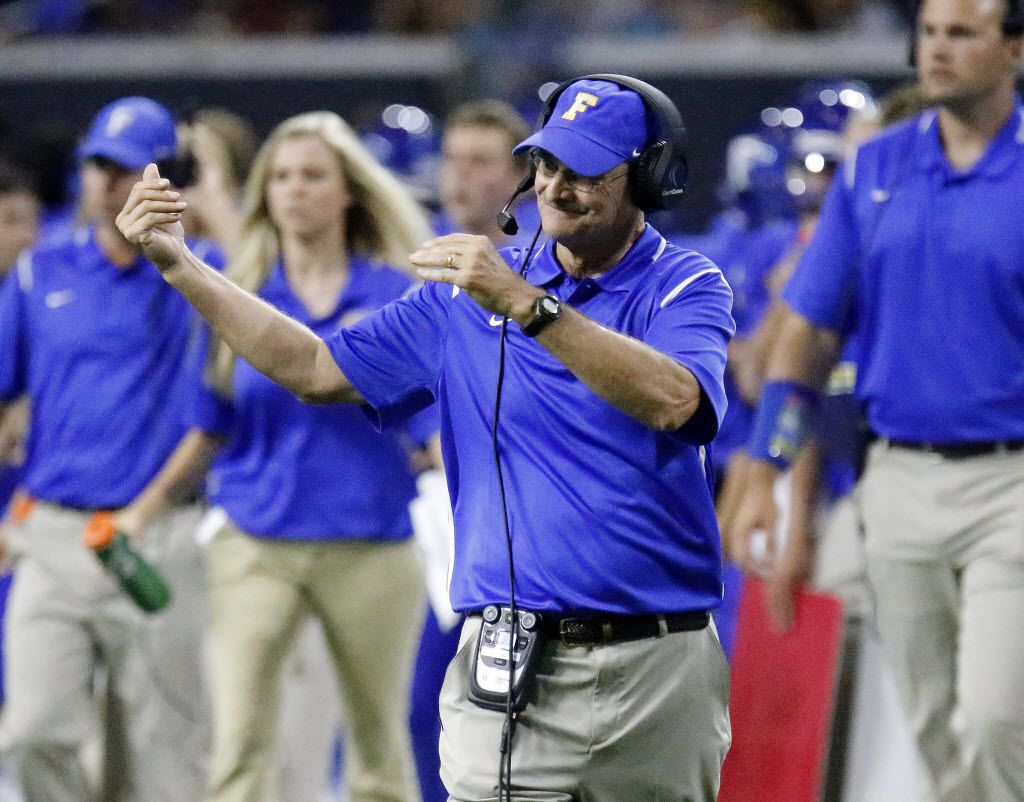 Frisco head coach Vance Gibson calls for one of his players between plays during the second half as Frisco High School played Centennial High School at The Star in Frisco on Saturday,  August 27, 2016.  His team went on to win 16-13. (Stewart F. House/Special Contributor)