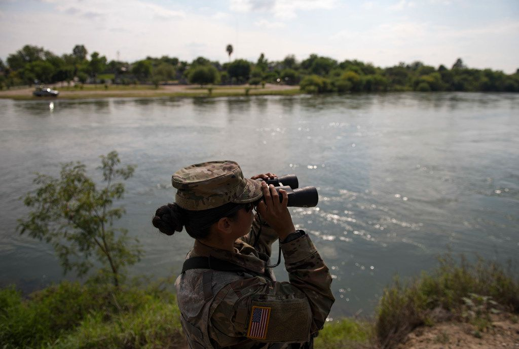 A Texas National Guard soldier watches over the Rio Grande in Starr County, Texas, April 10, 2018. As the National Guard begins a controversial mobilization on the southern border, soldiers are trying to fulfill two seemingly contradictory missions: standing out, and blending in.