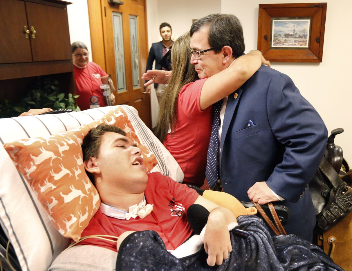 Gabriella McCann of Bulverde receives a hug from State Senator Peter Flores, R-District 19, during a visit with her medically fragile son, Briar, 15, at his office. Flores understands what families go through because he cares for his wife Elizabeth Flores who suffered a brain injury in her mid 30's.  Earlier in the day, McCann joined other parents of disabled and sick children at a rally hosted by Protect Fragile TX Children Tuesday.