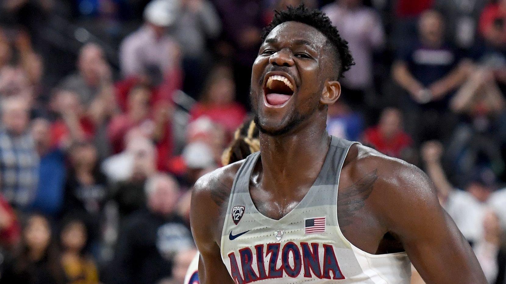 LAS VEGAS, NV - MARCH 10:  Deandre Ayton #13 of the Arizona Wildcats celebrates on the court after the team defeated the USC Trojans 75-61 to win the championship game of the Pac-12 basketball tournament at T-Mobile Arena on March 10, 2018 in Las Vegas, Nevada.  (Photo by Ethan Miller/Getty Images)