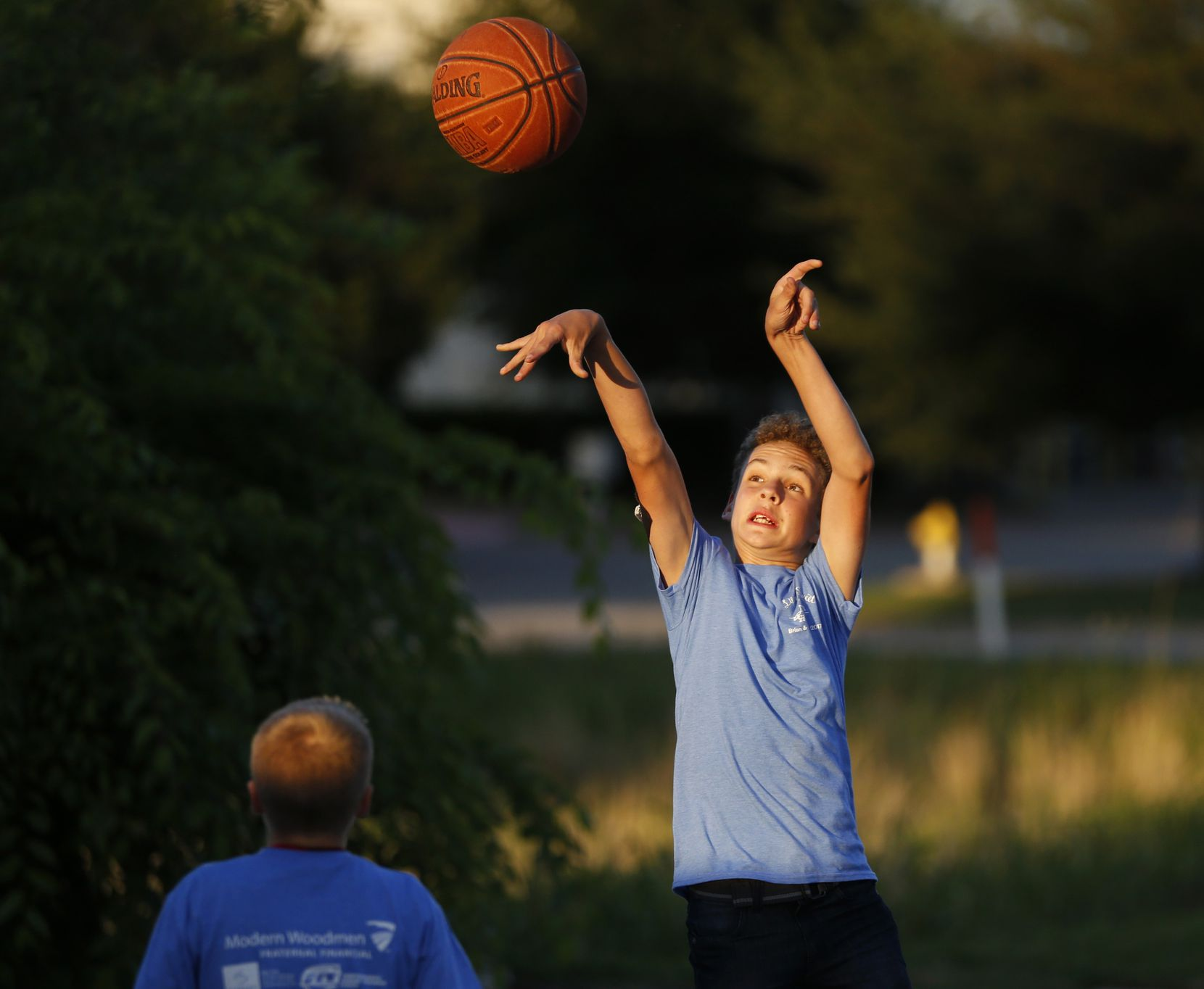 Brian Ellis shoots during a pickup basketball game during the Life is Sweet Carnival at Shawnee Trail Church of Christ in Frisco. The event featured a silent auction that helped raise money to train a diabetic alert dog for Ellis.