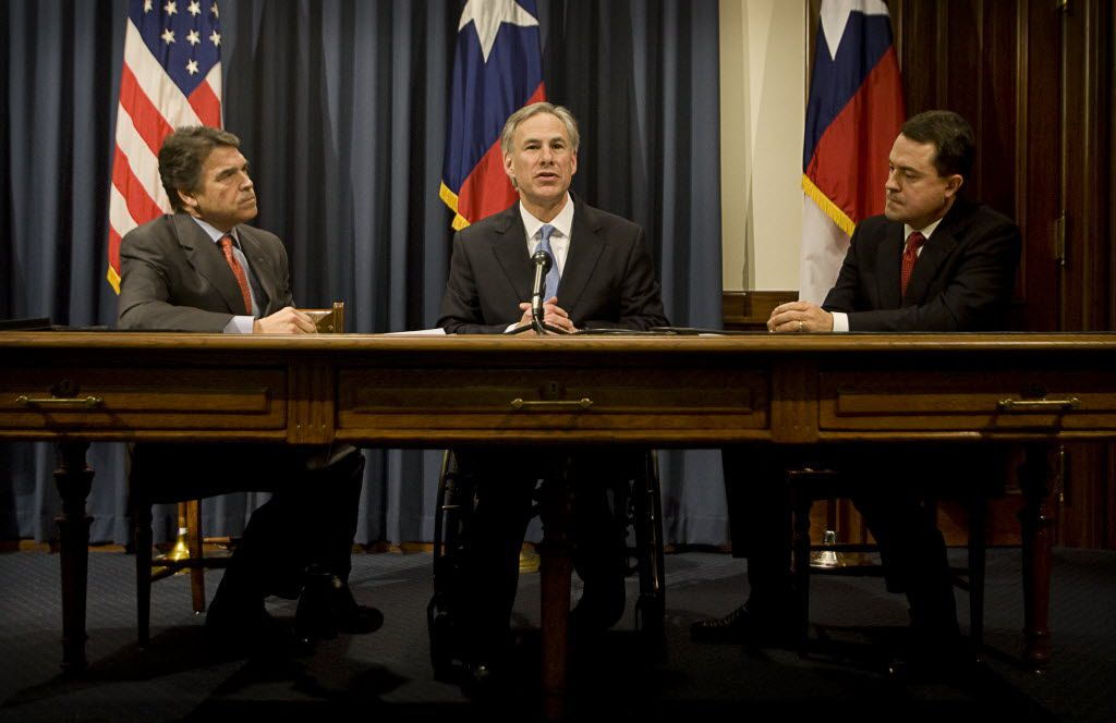 Texas Gov. Rick Perry, Attorney General Greg Abbott and Agriculture Commissioner Todd Staples at a news conference at the Capitol on Tuesday Feb. 16, 2010.
