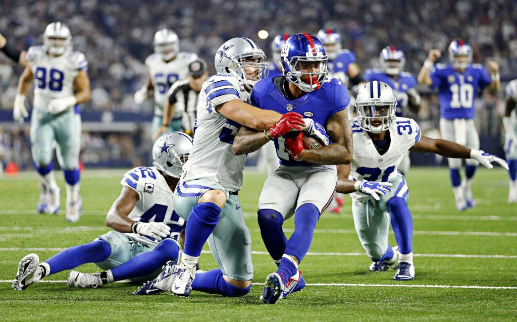 Dallas Cowboys middle linebacker Sean Lee (50) brings down New York Giants wide receiver Odell Beckham during the second half of their game Sunday, September 13, 2015 at AT&T Stadium in Arlington, Texas. (G.J. McCarthy/The Dallas Morning News)