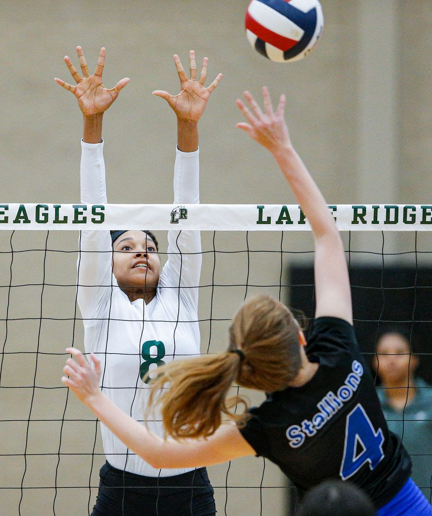 Mansfield Lake Ridge junior Lyric Stewart (8) attempts to block a spike by North Mesquite senior Lena Cates (4) during a high school volleyball game at Mansfield Lake Ridge High school in Mansfield, Tuesday, August 27, 2019. Lake Ridge won in three sets. (Brandon Wade/Special Contributor)