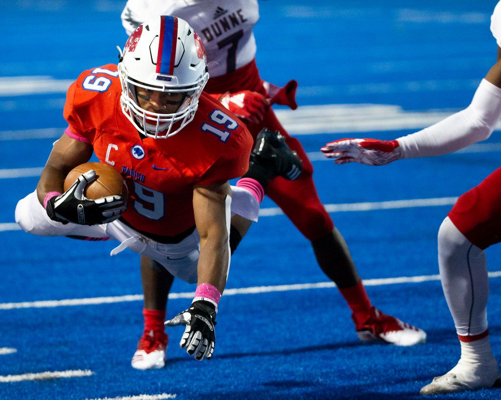 Parish Episcopal wide receiver Kaleb Culp (19) dives to earn yards during the football game between Parish Episcopal High School and Bishop Dunne Catholic School at the Gloria H. Snyder Stadium in Farmers Branch, Texas, on Friday, Oct. 11, 2019. (Lynda M. Gonzalez/The Dallas Morning News)