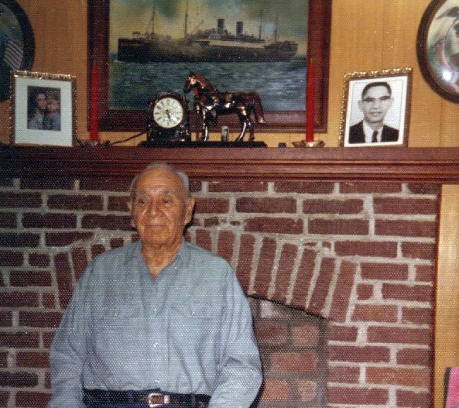 Thomas Cummings Sr., a World War I veteran, poses in front of his living room fireplace, which was a shrine to his military experience.