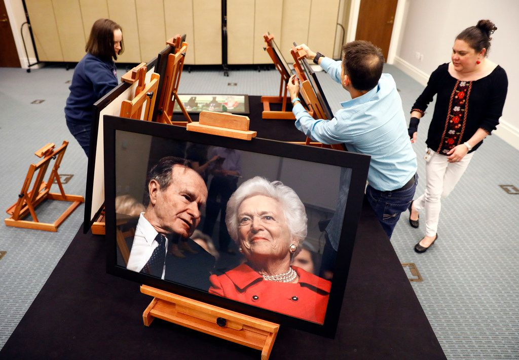From right: Christina Oliver, exhibit specialist Josh Millard and volunteer Teresa Ryant set up photos of former first lady Barbara Bush for a temporary exhibit at the George W. Bush Presidential Center in University Park.