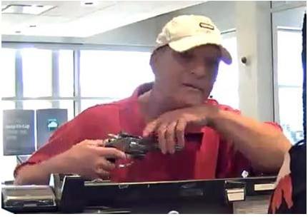 The man robbed the teller at gunpoint.