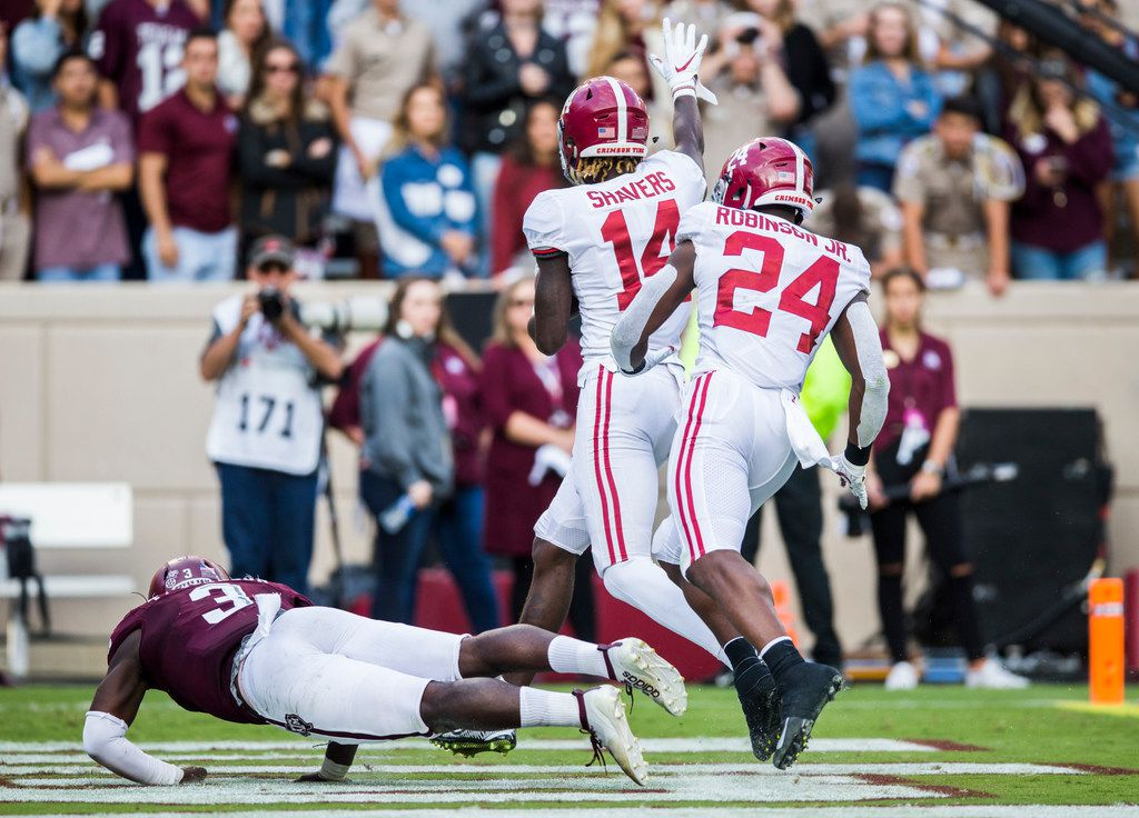 Alabama Crimson Tide wide receiver Tyrell Shavers (14) runs to the end zone for a touchdown after picking up a blocked punt and during the fourth quarter of a college football game between Texas A&M and Alabama on Saturday, October 12, 2019 at Kyle Field in College Station, Texas. Texas A&M Aggies defensive lineman Tyree Johnson (3) defends, and Alabama Crimson Tide running back Brian Robinson Jr. (24) is at right.