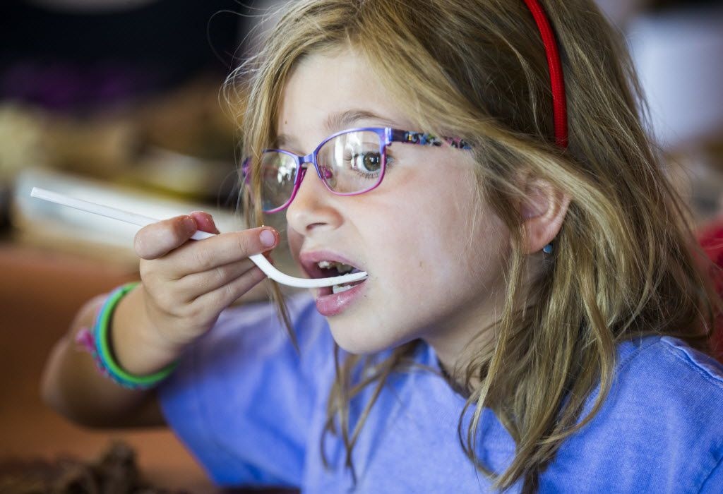 Charlotte Woods, 7, of Fort Worth eats green chile mac & cheese as Heim Barbecue opens a new location on Saturday, August 6, 2016 on W. Magnolia Ave. in Fort Worth.