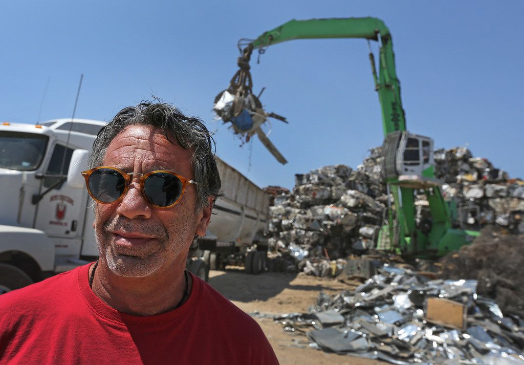 Laviage stands in the yard of his business, C&D Scrap Metal Recyclers in Houston.