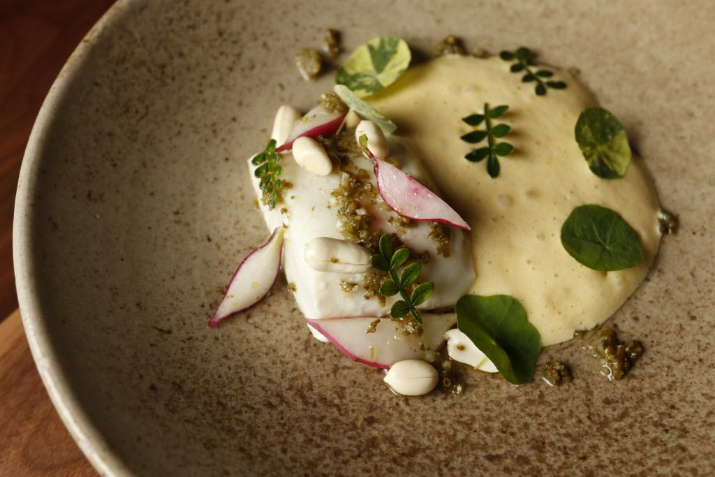 Halibut with radishes, green peanuts, pickled seaweed relish and savory sabayon at Uchi