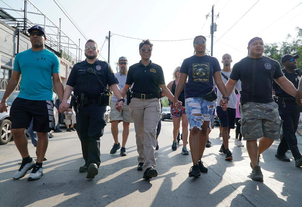 Dallas Police Chief U. Renee Hall  (third from left) walked with several of her police officers from Central Division in the Deep Ellum neighborhood on Sept.7. (Lawrence Jenkins/Special Contributor)