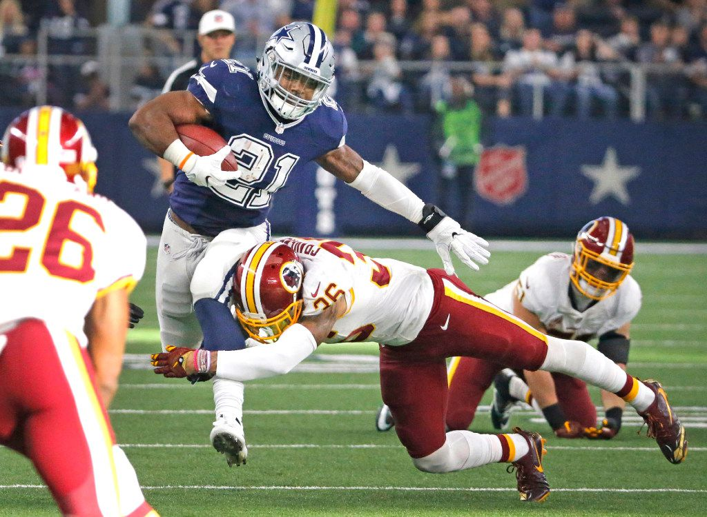 Dallas Cowboys running back Ezekiel Elliott (21) slices through the Redskins defense on a first quarter run as Washington Redskins inside linebacker Su'a Cravens (36) tries for the tackle during the Washington Redskins vs. the Dallas Cowboys NFL football game at AT&T Stadium in Arlington, Texas on Thursday, November 24, 2016. (Louis DeLuca/The Dallas Morning News)