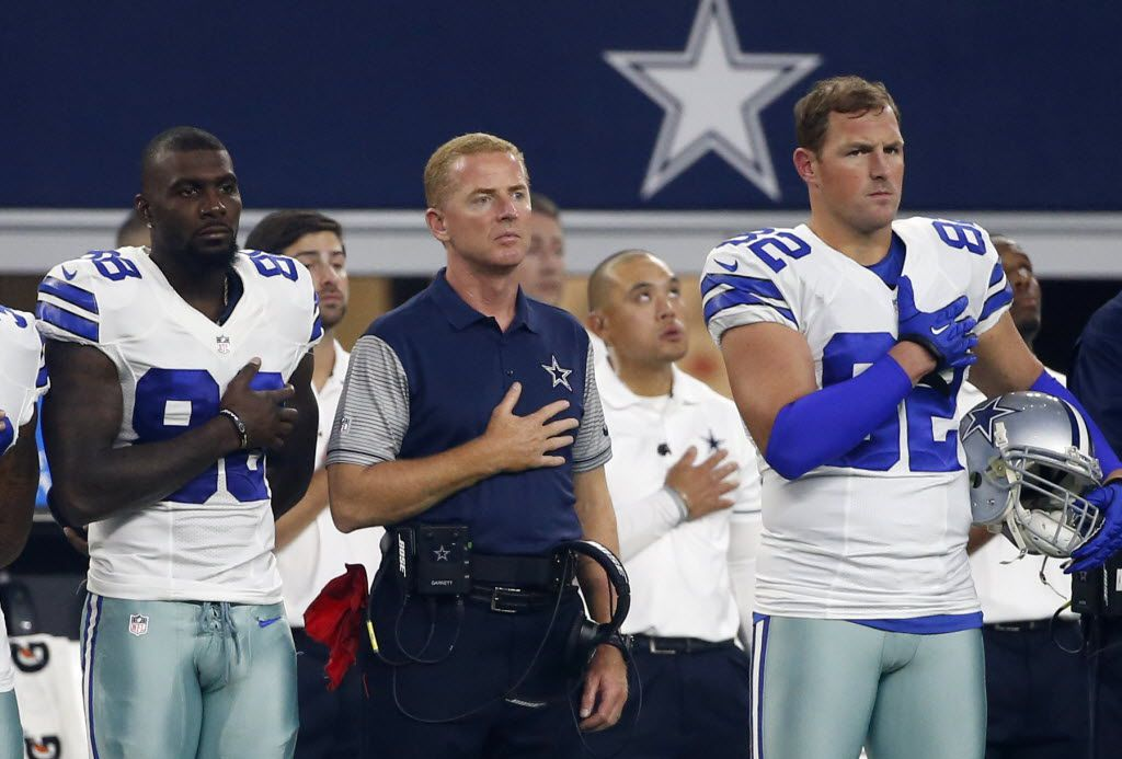 Dallas Cowboys' Dez Bryant, from left, head coach Jason Garrett and Jason Witten (82) stand during the playing of the national anthem before a preseason NFL football game against the Houston Texans on Thursday Sept. 1, 2016, in Arlington, Texas. (AP Photo/Michael Ainsworth)