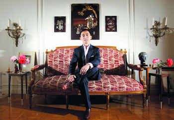 Quan Dang's love for French culture and design drew him to this late 19th-century Louis XVI settee ($400) from Lots of Furniture.
