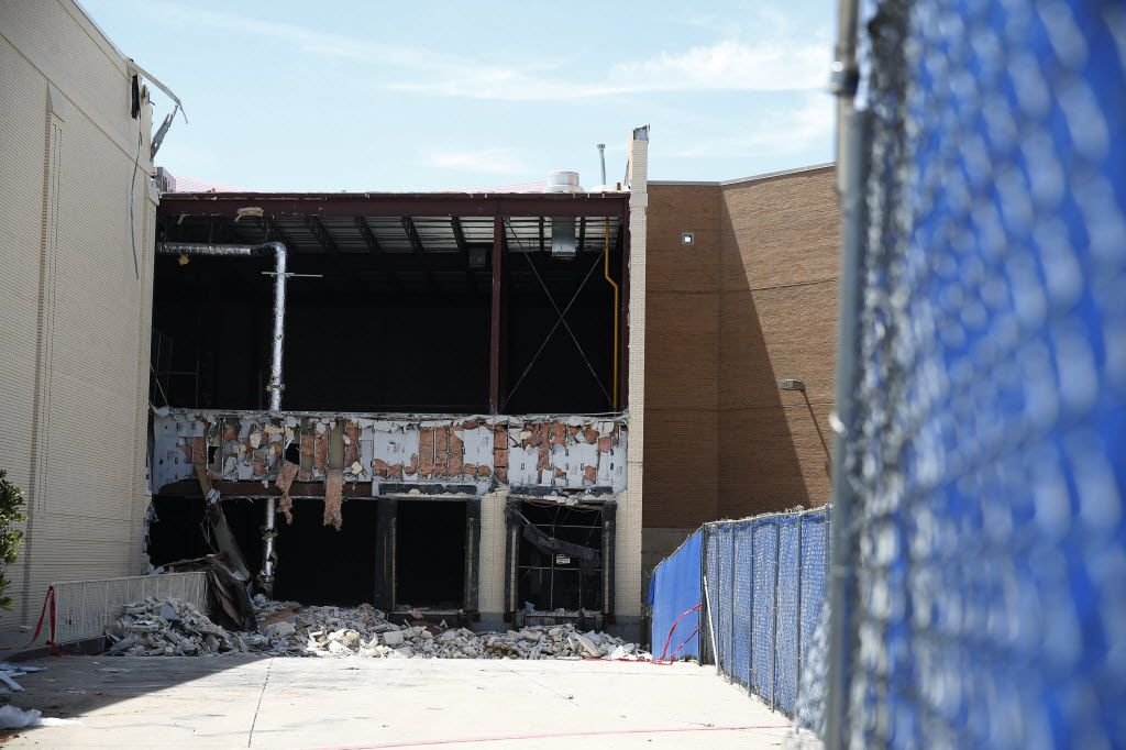 The exterior of a teardown of Saks Fifth Avenue at the Shops at Willow Bend in Plano on Aug. 25. About 70 percent of the metal, concrete and carpet is going to recyclers instead of a landfill, said developer Starwood Retail Partners.