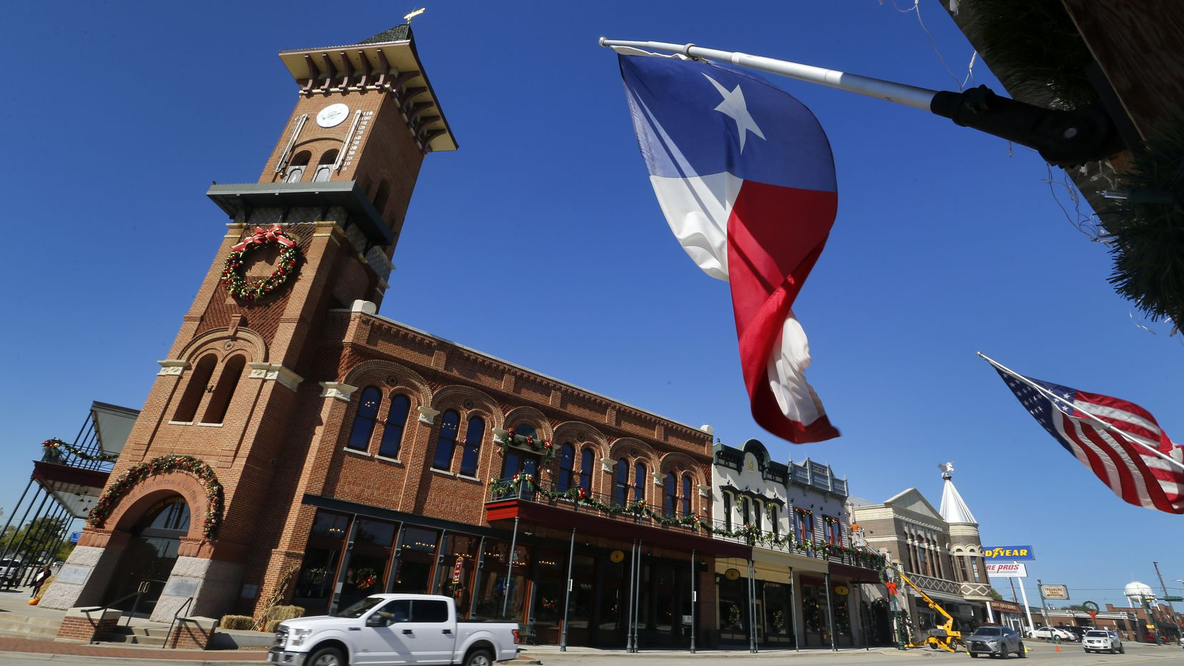 The Texas flag flies in front of the Grapevine Convention and Visitors Bureau building along the historic Main Street in downtown Grapevine.