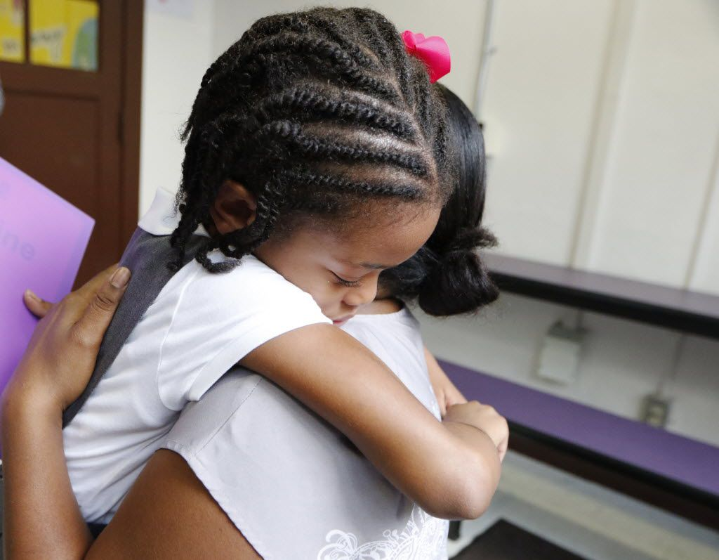 Nylah-Simone, 5, left, hugs her mother, Nneka Hobbs, (cq), on her first day of school at Solar Preparatory School for Girls in Dallas, Monday, August 22, 2016.  Solar Prep is the district's first attempt at a socio-economically balanced campus, with 50 percent of its students qualifying for free and reduced lunch and the other 50 percent who don't. (David Woo/The Dallas Morning News)