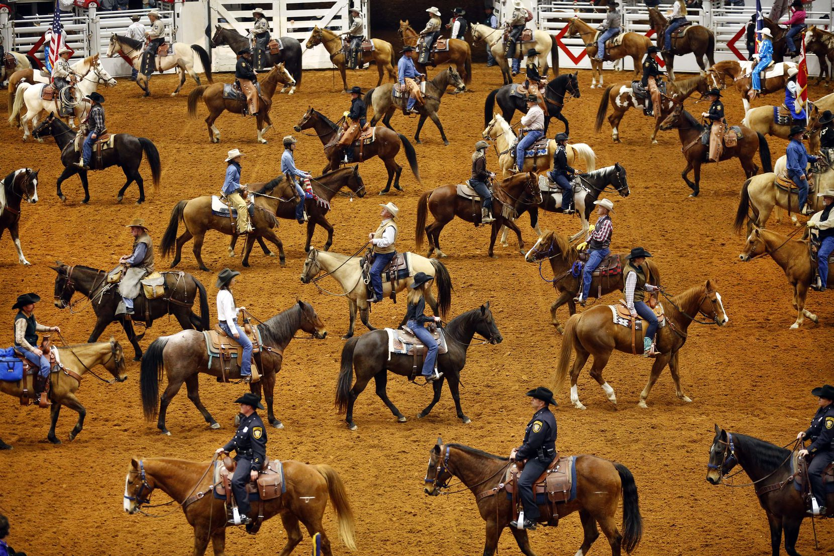 Stock Show officials, dignitaries, and participants on horseback form a serpentine line during the Grand Entry on Feb. 1 at Will Rogers Memorial Coliseum. The procession, which kicks off the Stock Show's PRCA rodeo, is a longtime tradition of the rodeo, dating back to the beginning in 1918.