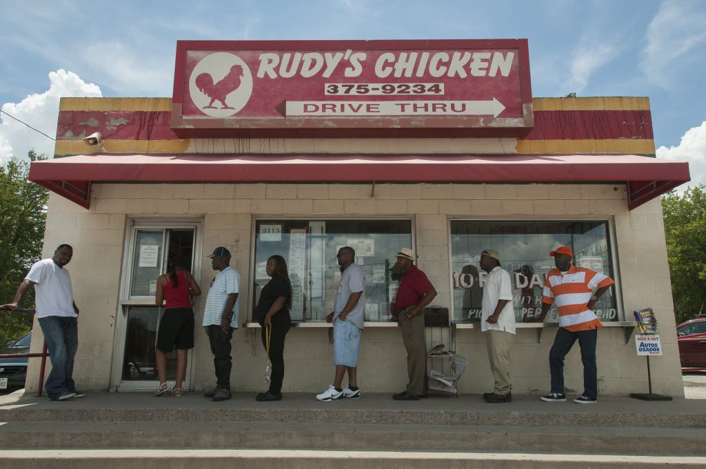 Customers line up to order from Rudy's Chicken on S. Lancaster.  It's owner Rudolph Edwards has received an $890,000 grant to build a new building next door.