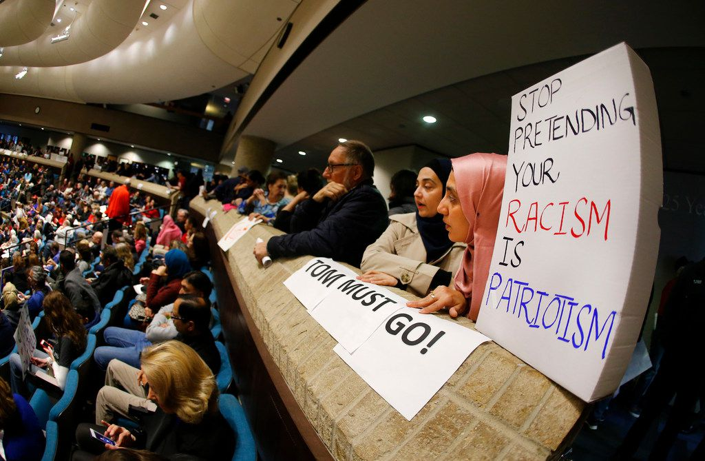 Mariam Khan, of Plano, (right) and her daughter Iman Siddiqui brought a box-top poster to a specially called council meeting to discuss fellow councilman Tom Harrison's anti-Islam social media post, Sunday, February 18, 2018 at Plano Municipal Center in Plano, Texas.  Harrison took the post down on Wednesday and posted an apology on Facebook. Harrison attended the public meeting and said he would not resign. (Tom Fox/The Dallas Morning News)