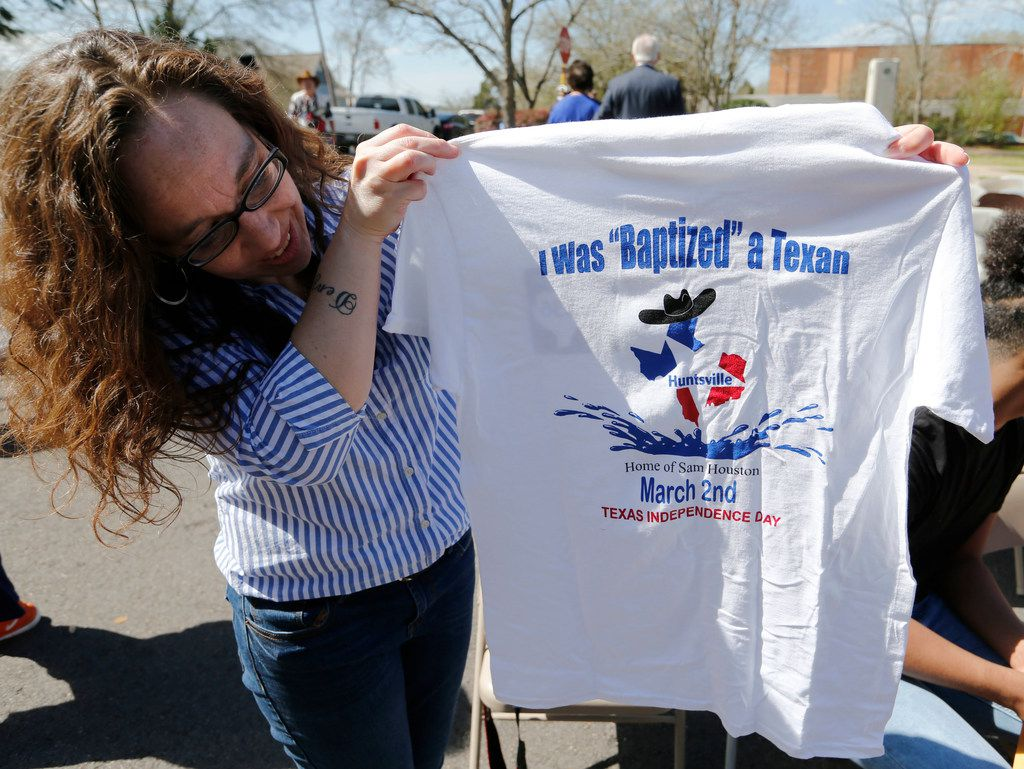 Fairlight Rice, originally from Denver, holds up the shirt she received after getting baptized a Texan.