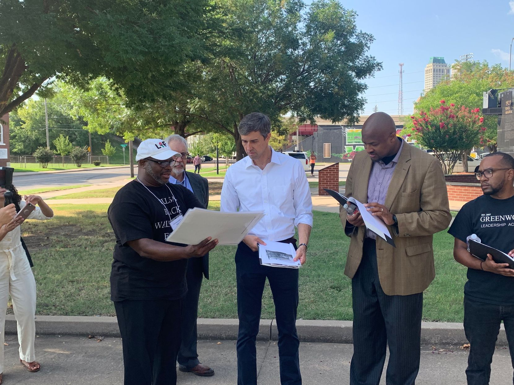 Presidential candidate Beto O'Rourke looks over documents related to the 1921 massacre  of the Greenwood neighborhood in Tulsa.