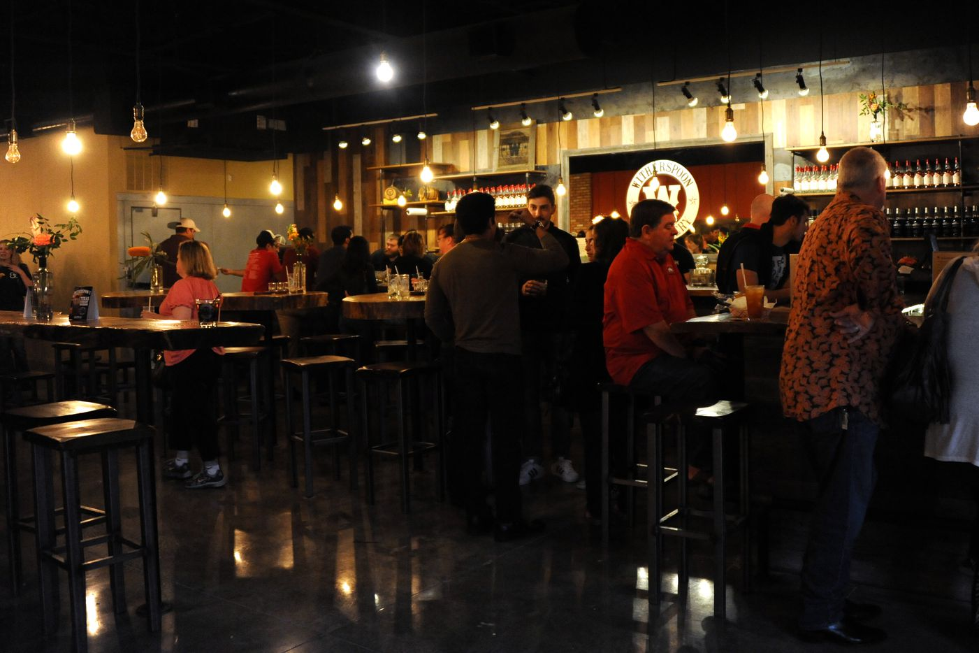 Guests relax and enjoy specialty cocktails in the bar at Witherspoon Distillery in Lewisville, TX on October 24, 2015.