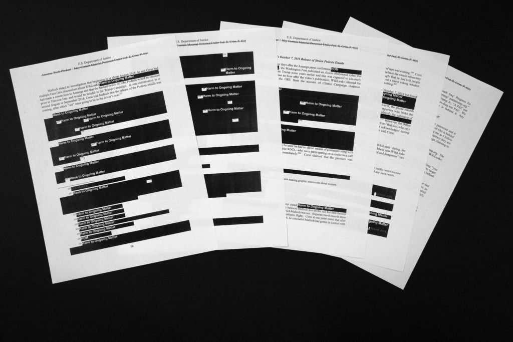 Special counsel Robert Mueller's redacted report on the investigation into Russian interference in the 2016 presidential election is photographed Thursday, April 18, 2019, in Washington. The pages deal with Julian Assange and WikiLeaks.