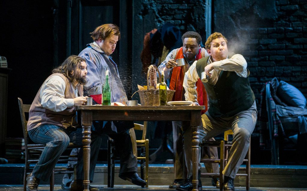 From left: Rodolfo, played by Jean-François Borras; Marcello, played by Anthony Clark Evans; Schaunard, played by Will Liverman; and Colline, played by Nicholas Brownlee, spit out their drinks during the final dress rehearsal of 'La bohème,' presented by the Dallas Opera at the Winspear Opera House in Dallas on Tuesday, March 12, 2019.