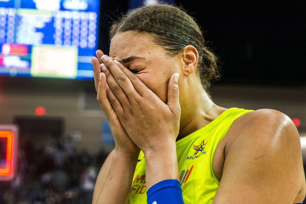 Dallas Wings center Liz Cambage (8) cries after the game against the Las Vegas Aces at College Park Center in Arlington, Texas on Aug. 17, 2018. The Wings defeated the Aces, 107-102. (Carly Geraci/The Dallas Morning News)