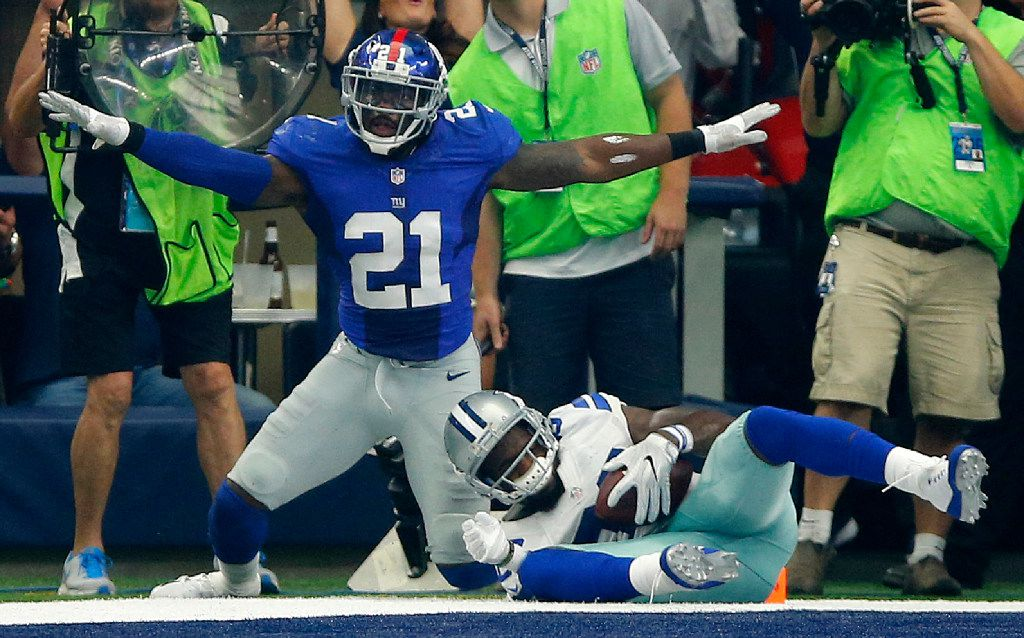 New York Giants free safety Landon Collins (21) signals no-catch on Dallas Cowboys wide receiver Dez Bryant's (88) near catch in the end zone during the first half at AT&T Stadium in Arlington, Texas, Sunday, September 11, 2016. Bryant lost control of the ball as he came down. (Tom Fox/The Dallas Morning News)