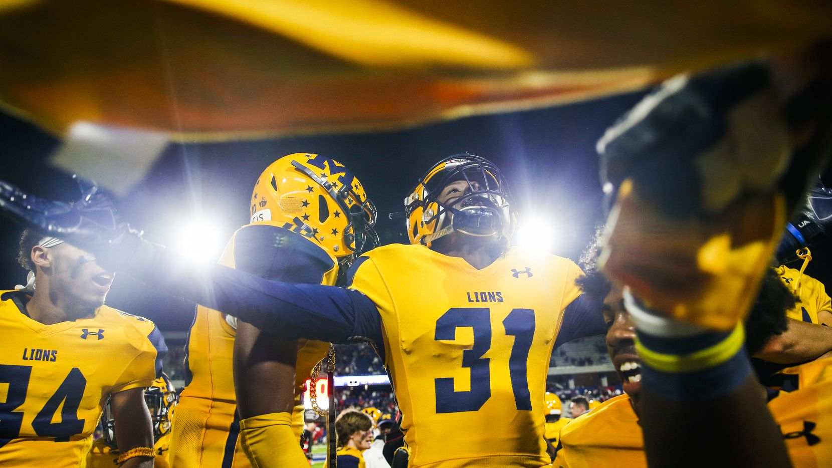 McKinney players celebrate in the final moments of their win over McKinney Boyd during a high school football matchup at McKinney ISD Stadium on Friday, Nov. 8, 2019 in McKinney, Texas. (Ryan Michalesko/The Dallas Morning News)