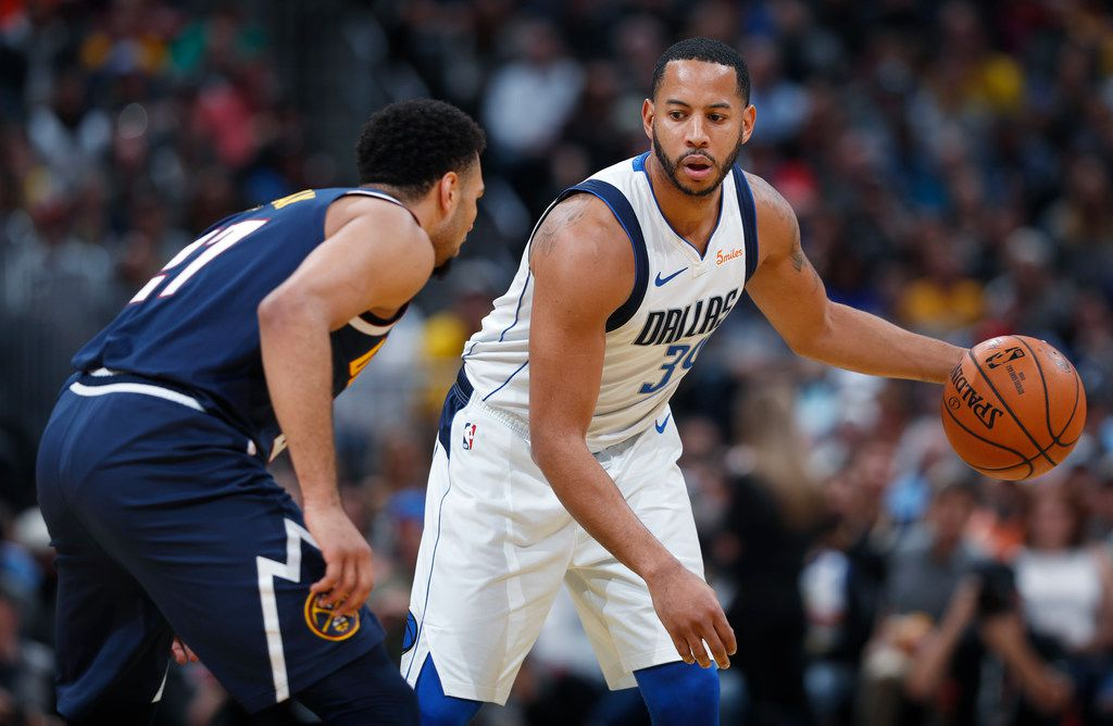 Dallas Mavericks guard Devin Harris, right, looks to pass the ball as Denver Nuggets guard Jamal Murray defends in the first half of an NBA basketball game Tuesday, Dec. 18, 2018, in Denver. (AP Photo/David Zalubowski)