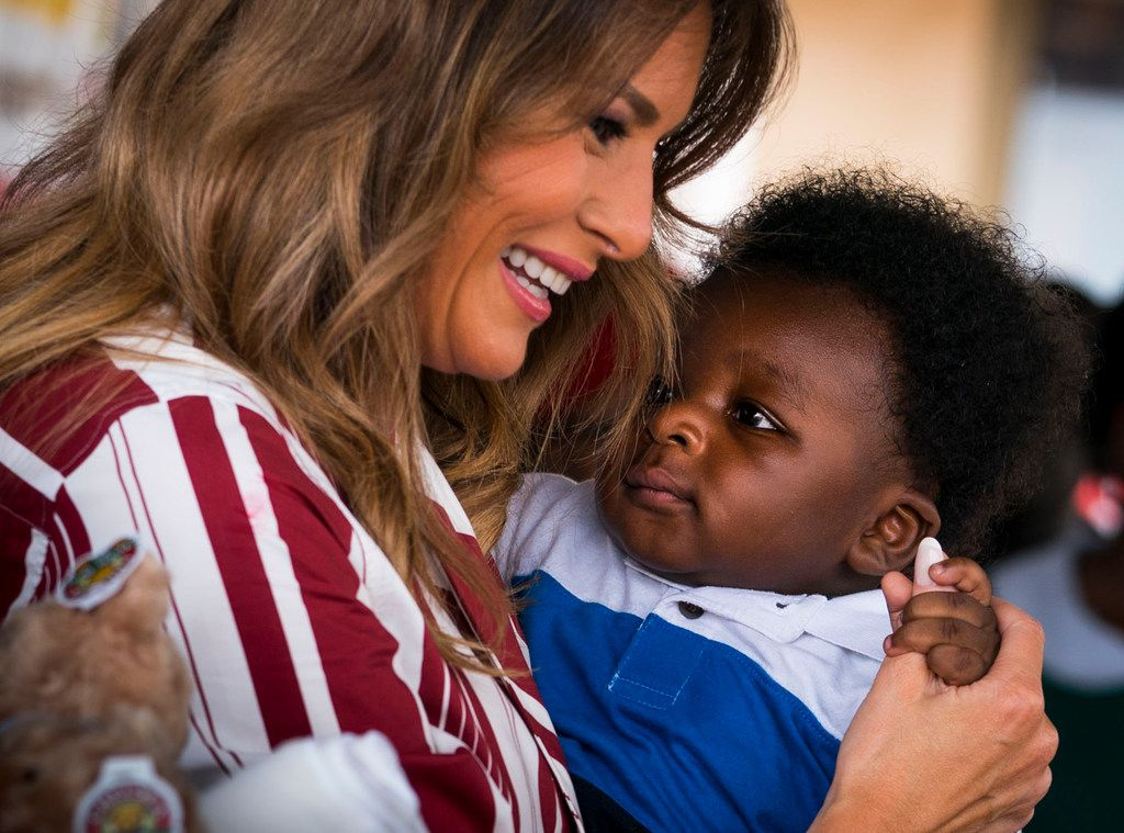 First lady Melania Trump holds a 6-month-old baby as she hands out teddy bears and Be Best-themed blankets donated by the White House to young children and their mothers at the Greater Accra Regional Hospital in Accra, Ghana, Oct. 2, 2018.