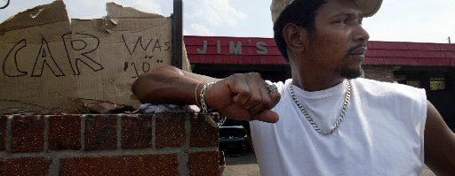 Stacy Bennett waits for customers at Jim's Car Wash on Martin Luther King Blvd. in 2004. (Staff photo)