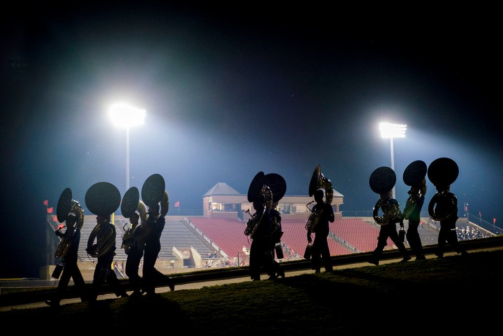 Members of the Hebron band head for the buses after a victory over Coppell in a high school football game on Friday, Oct. 4, 2019, in Coppell, Texas. (Smiley N. Pool/The Dallas Morning News)