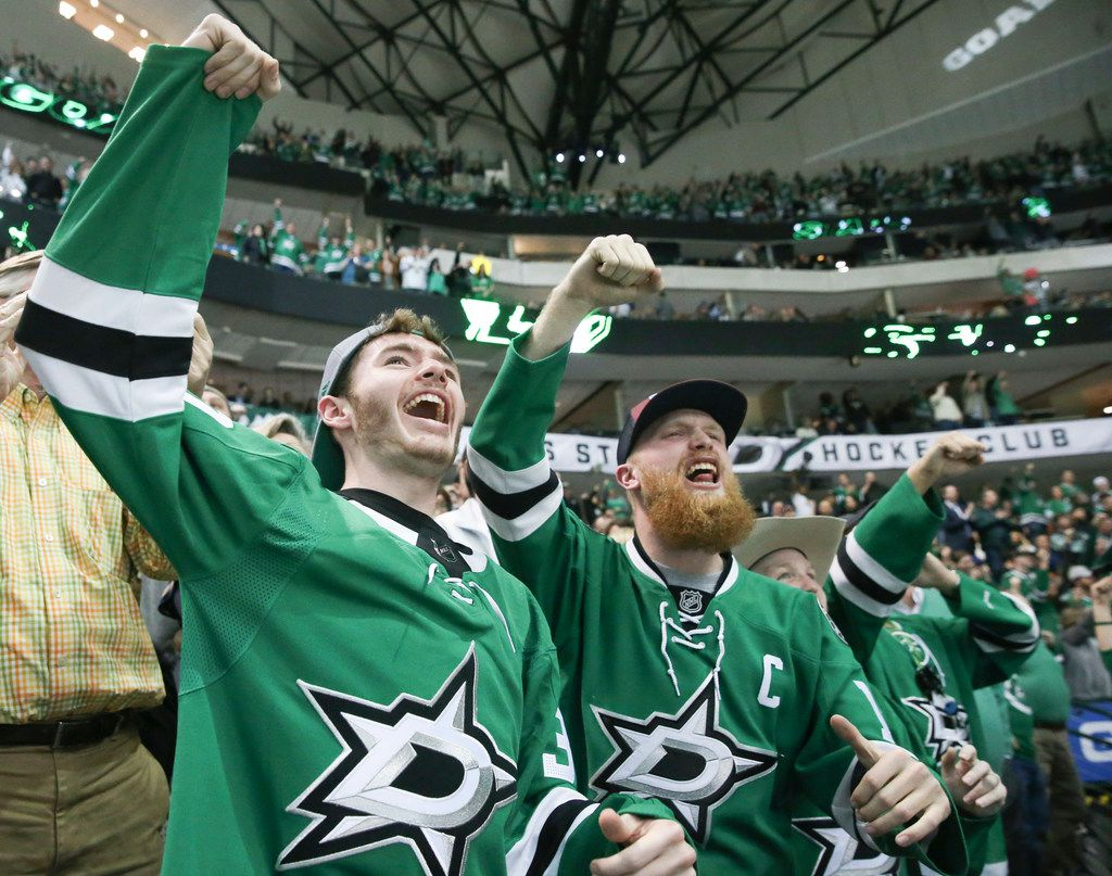 Carsen Bishop, left, celebrates with Christian Crocker, right, after the Stars scored during the second period Tuesday at American Airlines Center in Dallas. The Stars clinched a playoff berth with a 6-2 win over the Philadelphia Flyers.