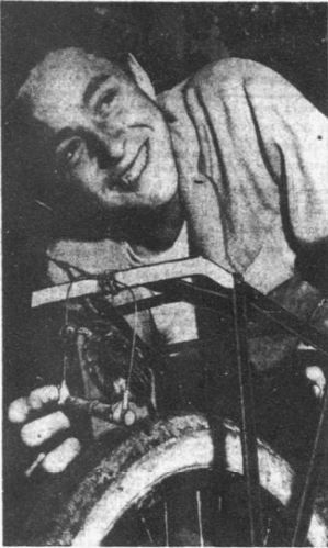 April 16, 1954: Orphaned by a storm, this little English sparrow is being taught to fly by Richard DeLeon