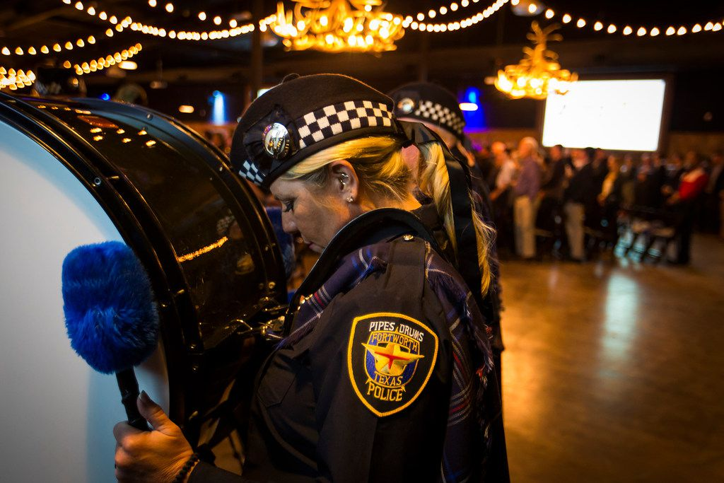 Members of the Fort Worth Police Pipes & Drums observe a moment of silence for fallen police officers during at a campaign event for Sen. Ted Cruz at River Ranch Stockyards on Wednesday, April 4, 2018, in Fort Worth, Texas.