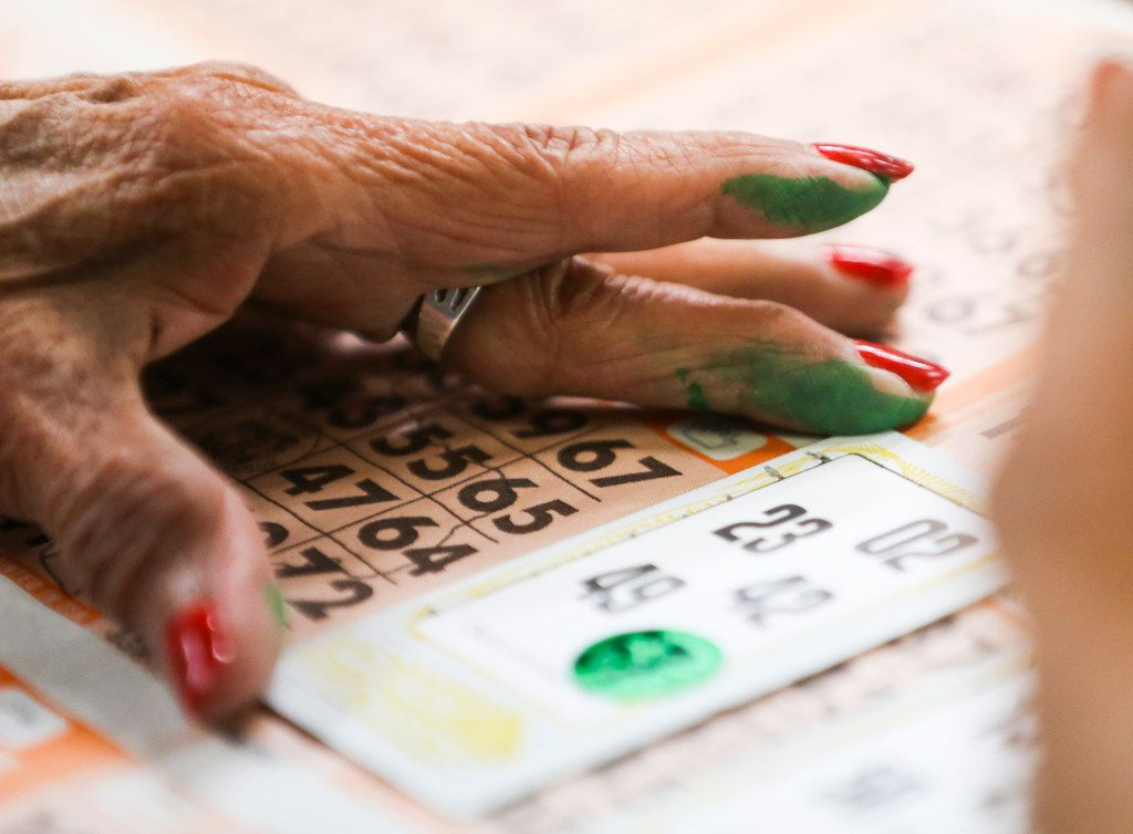 Rosa Corona, of Dallas, marks her bingo cards during a round of bingo at Jackpot Bingo on Thursday, April 11, 2019 in Duncanville, Texas.