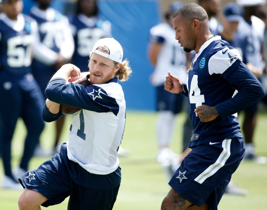 Dallas Cowboys wide receiver Cole Beasley (11) runs up the field with the ball as Dallas Cowboys defensive back Nolan Carroll (24) closes in on him in the morning walk through during training camp in Oxnard, California on Monday, July 24, 2017. (Vernon Bryant/The Dallas Morning News)