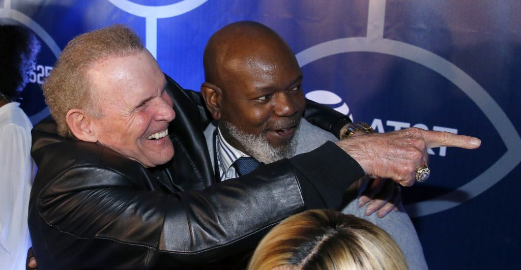 Former Dallas Cowboys football player Emmitt Smith (right) and former director of operations Bruce Mays on the Blue Carpet during the 25th Anniversary of the Dallas Cowboys Super Bowl XXVII at Gilley's in Dallas, Saturday, February 25, 2017. The event was hosted by Troy Aikman and United Way of Metropolitan of Dallas in which he is the new fundraiser. The evening featured appearances by Cowboys legends, a conversation with head coach Jimmy Johnson and other members of the 1992 coaching staff, and a special celebration honoring Jerry Jones for his election to the Pro Football Hall of Fame. (Tom Fox/The Dallas Morning News)