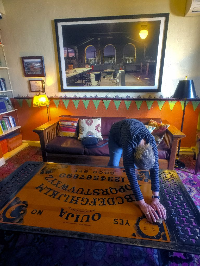 At the haunted Hotel Congress in Tucson, a Ouija board table provides visitors with a possible way to contact the other side.