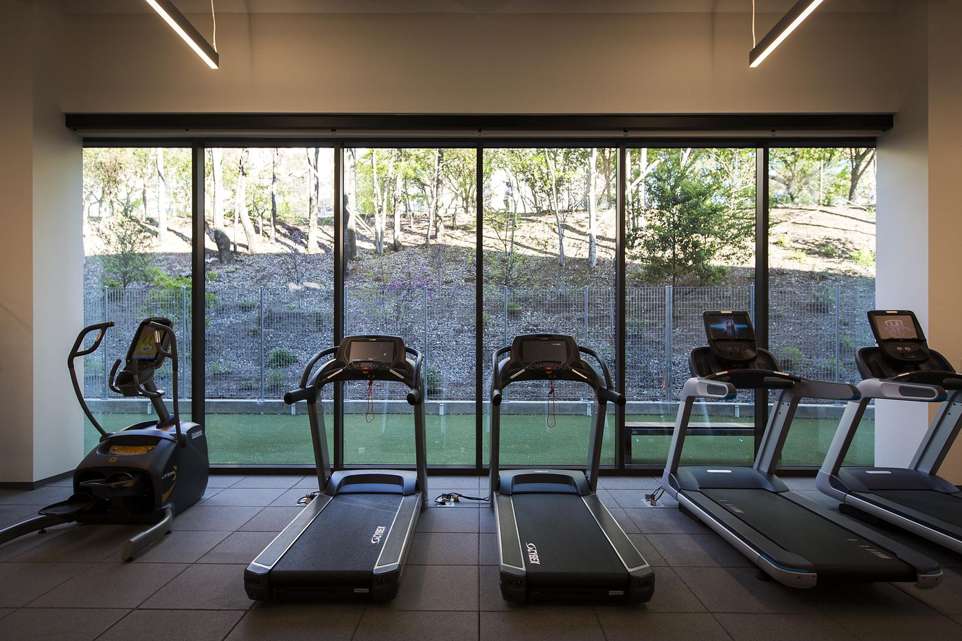 The fitness center at the new headquarters for Perot companies looks out onto the Katy Trail.